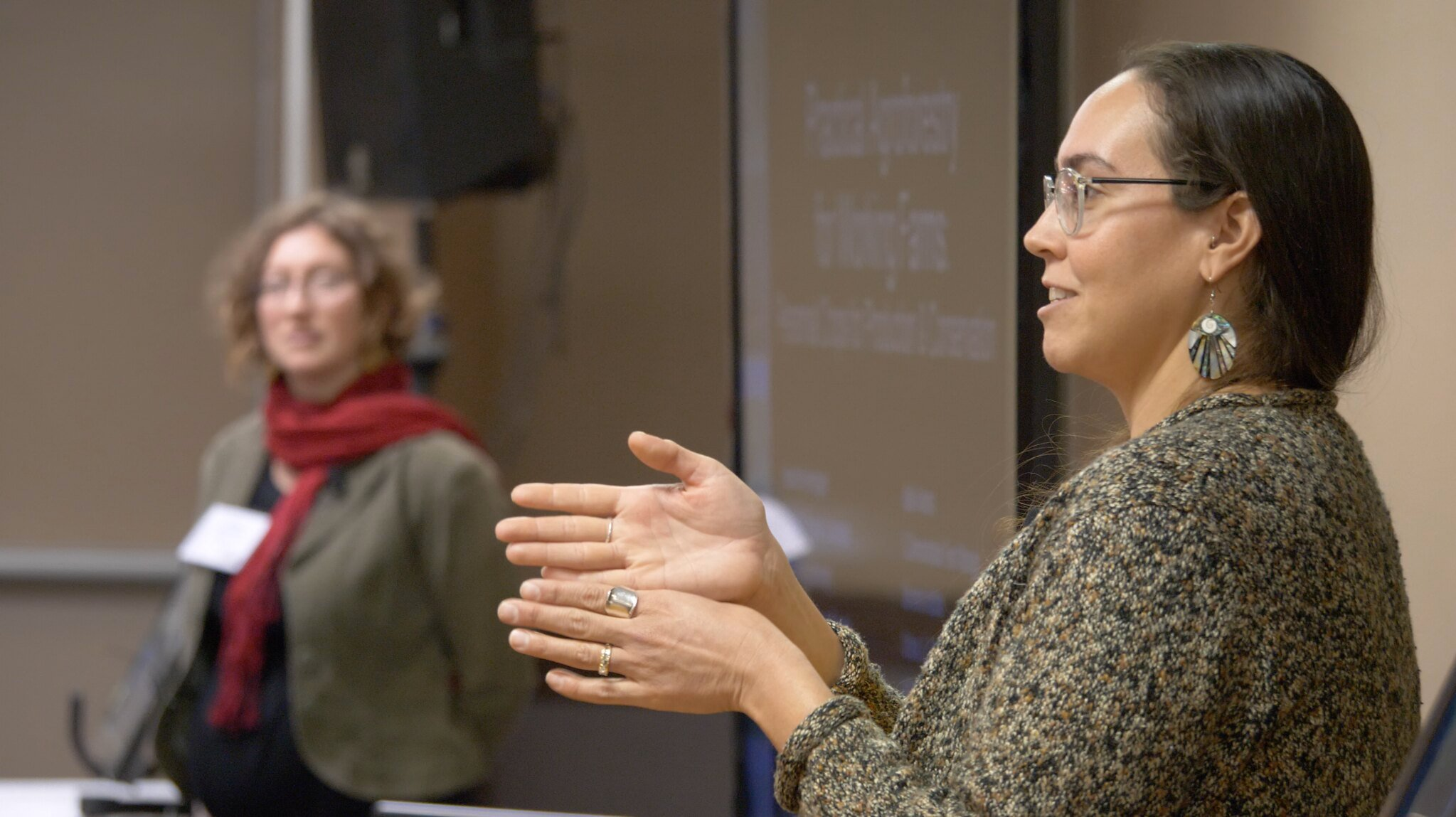 a woman presents to an audience